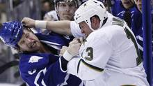 Toronto Maple Leafs Colton Orr fights with Dallas Stars Krystofer Barch (R) during the first period of their NHL hockey game in Toronto November 22, 2010. (Reuters)