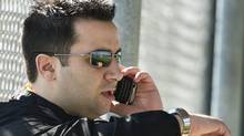 Toronto Blue Jays Senior Vice President of Baseball Operations and General Manager Alex Anthopoulos talks on his cell phone as he looks at his watch during baseball spring training in Dunedin, FL, on Wednesday, Feb. 16, 2011. THE CANADIAN PRESS/Nathan Denette (Nathan Denette)