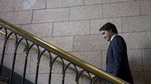 Liberal Leader Justin Trudeau leaves a news conference after speaking with the media following caucus on Parliament Hill Wednesday June 18, 2014 in Ottawa. (Adrian Wyld/THE CANADIAN PRESS)