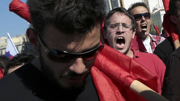 Protesters from the communist-affiliated trade union PAME march outside the parliament during a rally in central Athens Nov. 6, 2012. Hundreds of thousands of Greeks began a crippling 48-hour strike on Tuesday to protest against a new round of wage and pension cuts that parliament is expected to approve narrowly on Wednesday. (STRINGER/REUTERS)