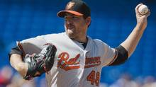 Baltimore Orioles Joe Saunders pitches to the Toronto Blue Jays during the first inning of their MLB American League baseball game in Toronto, September 3, 2012. (MARK BLINCH/REUTERS)