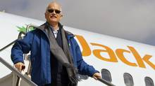 NDP Leader Jack Layton leaves his campaign plane as he arrivesin Charlottetown on April 15, 2011. (Jacques Boissinot/The Canadian Press)