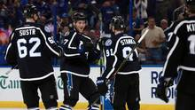 Tampa Bay Lightning defenseman Victor Hedman (77) is congratulated by defenseman Andrej Sustr (62) and center Steven Stamkos (91) after scoring against the Toronto Maple Leafs during the second period at Amalie Arena. (Kim Klement/USA Today Sports)