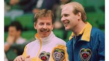 Manitoba skip Vic Peters (left) and Alberta skip Kevin Martin chat between ends at the morning draw of the Labatt Brier in Calgary, March 11, 1997. (CP)