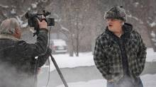 Brandon Blackmore, right, yells at a cameraman as he leaves the courthouse in Cranbrook, B.C., Friday, Feb. 3, 2017. A B.C. Supreme Court judge delivered his ruling in the case of three people who are accused of removing girls from Canada so they could be placed in plural marriages. (Jeff McIntosh/THE CANADIAN PRESS)