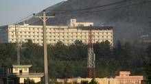 Smoke rises from the Inter-Continental hotel after it was attacked by militants in Kabul, Afghanistan, early Wednesday, June 29, 2011. (Musadeq Sadeq/AP)