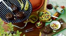 From left: Fox Run barbecue fork, $13.99 at Whole Foods; Bodum Charcoal Grill, $59.99 at Indigo. Williams-Sonoma metal tongs, $30, boar-bristle brush, $15, yellow ceramic bowl with handles, $76, green jacquard tablecloth, $42.90, napkin rings, $16 for set of four, cedar grilling plank, $7.57, seashell salt and pepper dishes with spoons, $10. Striped Tag napkins, $16.99 for set of three, coloured measuring cups, $14.99 for set of four at Whole Foods. (Photo: Jim Norton; Styling: Heather Shaw/Judy Inc.)