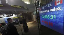 A screen showing the S&P TSX composite index down over 190 points in the afternoon at the TMX Broadcast Centre in The Exchange Tower in Toronto. (Deborah Baic/Deborah Baic/The Globe and Mail)