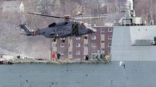 """A Canadian military CH-148 Cyclone conducts training exercises with HMCS Montreal in Halifax harbour on March 29, 2010. The federal government announced a deal with aircraft-manufacturer Sikorsky to start receiving 28 """"fully capable"""" CH-148 Cyclone helicopters in 2018. (ANDREW VAUGHAN/THE CANADIAN PRESS)"""