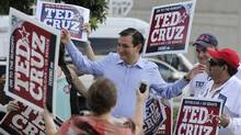 Former Texas Solicitor General Ted Cruz, center, greets supporters at a voting precinct Tuesday, July 31, 2012, in Houston. (Pat Sullivan/The Associated Press)