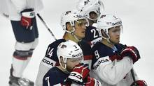 J.T. Compher, Nick Bjugstad, Anders Lee and Andrew Copp gather after losing the Ice Hockey World Championships quarterfinal match between the United States and Finland in the LANXESS arena in Cologne, Germany, Thursday, May 18, 2017. (Martin Meissner/AP)
