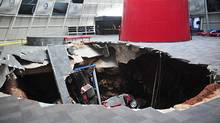 This image provided by the National Corvette Museum shows several cars that collapsed into a sinkhole Wednesday, Feb. 12, 2014, in Bowling Green, Ky (AP/National Corvette Museum)
