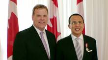 Former Foreign Affairs Minister John Baird presents Richard Li, Chairman of PCCW Limited, with a Queen Elizabeth II Diamond Jubilee medal in recognition of Mr. Li's outstanding business and charitable contributions to Canada. (Foreign Affairs, Trade and Development Canada)