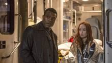 Actors Lyriq Bent, left, and Elyse Levesque are shown in a scene from CBC's Shoot The Messenger. (CBC/THE CANADIAN PRESS)