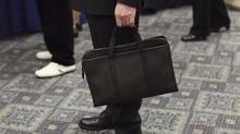 A man holds his briefcase at a job fair in New York April 18, 2012. (Shannon Stapleton/Reuters)