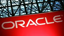 An Oracle sign is shown at the National Retail Federation convention on Tuesday, January 15, 2008 in New York. (MARK LENNIHAN/AP)
