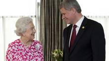 Prime Minister Stephen Harper meets with Britain's Queen Elizabeth during the Commonwealth Heads of Government Meeting in Port of Spain, Republic of Trinidad and Tobago, on Nov. 27, 2009. (Sean Kilpatrick)