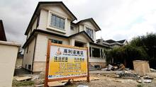 A contractor's sign stands outside a mansion currently under construction in a Vancouver neighbourhood popular with Chinese buyers in this file photo. (Julie Gordon/REUTERS)