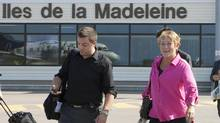 Parti Québécois Leader Pauline Marois, right, leaves with staff member Frederic Cote on her way to her campaign plane flying out of the Magdalen Islands after a campaign stop, on Aug. 6, 2012 . (Jacques Boissinot/THE CANADIAN PRESS)