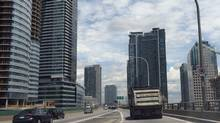 A dump truck heads east along the Gardiner Expressway past the York and Bay Street off-ramps on June 18, 2013. (FRED LUM/THE GLOBE AND MAIL)
