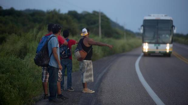 Often on the highway between Arriaga, Chiapas and Chahuites, the bus meant to shuttle migrants to the village where they can find shelter doesn't stop, leaving them to walk.