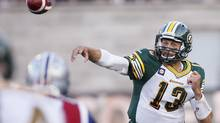 Edmonton Eskimos quarterback Mike Reilly throws against Montreal Alouettes during first half CFL football action in Montreal, August 8, 2014. (CHRISTINNE MUSCHI/REUTERS)
