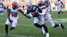Jason Witten of the Dallas Cowboys runs after a catch against Tramon Williams and Christian Kirksey of the Cleveland Browns on Nov. 6, 2016. (Jason Miller/Getty Images)