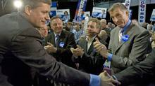 Maxime Bernier applauds Conservative Leader Stephen Harper at an election rally in Quebec City on Oct 12, 2008. (Tom Hanson)