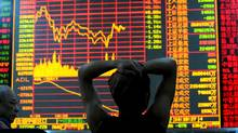 An investor views stock indexes at a securities company in Wuhan of Hubei Province, China. (China Photos/Getty Images)