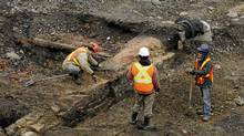 Photographs of an archaeological site south of Front St. West and immediately east of Bathurst St. on April 18 2011. Developers of a condominium and public library near Fort York have discovered the archaeological remains of an engine storage and maintenance complex built by the Grand Trunk railway in the 1850s. (Fred Lum/The Globe and Mail)