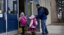 A nixed walkout meant Hilton Barbour's daughters Savanna and Monet, went to school Friday. (Chris Young for The Globe and MaIL)