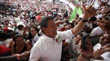 Enrique Pena Nieto, presidential candidate of the opposition Institutional Revolutionary Party (PRI), is cheered by supporters during a rally in Morelia, in the Mexican state of Michoacan, on Tuesday. (Tomas Bravo/Reuters)