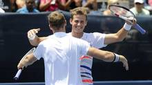Vasek Pospisil, right, celebrates with doubles partner Jack Sock after they defeated Steve Johnson and Sam Querry 6-3, 5-7, 10-5 to win the final in the Atlanta Open tennis tournament Sunday, July 27, 2014, in Atlanta. (Dave Tulis/AP)