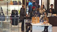 Shoppers browse in Michael Kors at West Edmonton Mall (JASON FRANSON FOR THE GLOBE AND MAIL)