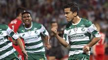Juan Pablo Rodriguez of Mexico's Santos Laguna, right, celebrates after taking a penalty kick to score against Canada's Toronto F.C. during a semi-final match of the CONCACAF Champions League in Torreon, Mexico, Wednesday April 4, 2012. (Alberto Puente)