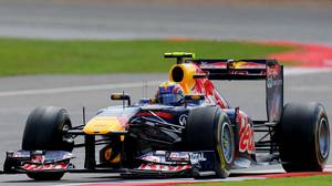 Red Bull Racing's Australian Formula One driver Mark Webber drives at the Silverstone circuit on July 10, 2011.