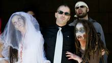 Rémy Couture, centre, demonstrates outside the Montreal courthouse with supporters dressed as zombies last week. (Graham Hughes/CP)