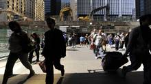 Commuters making their way towards Union Station, June 14 2012. (Fred Lum/Fred Lum/The Globe and Mail)