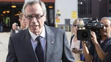Federal Finance Minister Joe Oliver arrives for the announcement of a renewed Federal Gas Tax fund at a TTC transit yard in Toronto on Friday, July 11, 2014. (Chris Young/The Canadian Press)