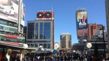 A City of Toronto proposal shows this rendering of the Sam the Record Man sign atop a building at Yonge-Dundas Square (City of Toronto)