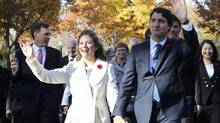 Wearing the Sentaler coat, Sophie Grégoire Trudeau walks with her husband, Prime Minister Justin Trudeau, to Rideau Hall for the government's swearing-in ceremony in Ottawa. (Chris Wattie/Reuters)