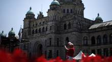A view of the B.C. legislature in Victoria. The province and one of its public-service unions have reached a five-year deal that ties future pay hikes to economic growth. (CHAD HIPOLITO For The Globe and Mail)