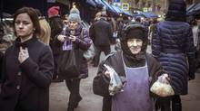 A woman sells pickled cabbage at a street market in Moscow, Russia, Friday December, 19, 2014. (Sergey Ponomarev)