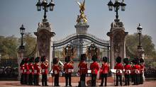 The Band of the Coldstream Guards form up around the main gate of Buckingham Palace during the Changing of the Guard ceremony on April 20, 2011, in London (PETER MACDIARMID/PETER MACDIARMID/AFP/Getty Images)