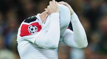 Wayne Rooney of Manchester United shows his dejection after the UEFA Champions League final between FC Barcelona and Manchester United FC at Wembley Stadium on May 28, 2011 in London, England. (Photo by Shaun Botterill/Getty Images) (Shaun Botterill/Getty Images)