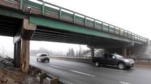 Traffic flows under the Prospect Road overpass along Highway 102 in Halifax, March 13, 2014. Recently discovered structural damage underneath the bridge has raised concern about the safety of the structure. (Mike Dembeck/THE CANADIAN PRESS)
