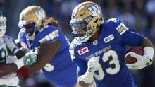 Winnipeg Blue Bombers' Andrew Harris (33) runs against the Saskatchewan Roughriders during first half CFL Banjo Bowl action, in Winnipeg on September 10, 2016. (John Woods/THE CANADIAN PRESS)