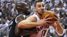 Toronto Raptors centre Jonas Valanciunas drives to the net against Brooklyn Nets centre Kevin Garnett during the first half of Game 2 during the first round of the 2014 NBA Playoffs at Air Canada Centre. (USA TODAY Sports)