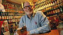 Beer-paraphernalia aficionado Larry Sherk in his friend's basement brewery collectables room in Etobicoke, where a group of collectors meet every Thursday night. Last year, Mr. Sherk donated his array of some 3,000 beer labels to the rare-books library at the University of Toronto. (Deborah Baic/Deborah Baic/The Globe and Mail)