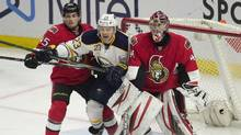 Buffalo Sabres' centre Sam Reinhart (23) is sandwiched between Ottawa Senators' goalie Craig Anderson and defenceman Chris Wideman (45) during third period NHL action, in Ottawa on Tuesday, Feb. 16, 2016. The Senators defeated the Sabres 2-1. (Adrian Wyld/THE CANADIAN PRESS)